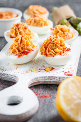 deviled eggs appetizer with hummus. green asparagus