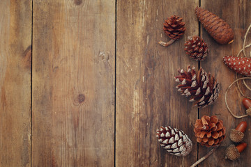 Top view of pine cones on wooden background