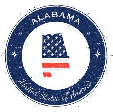 Alabama circular patriotic badge. Grunge rubber stamp with USA state flag, map and the Alabama written along circle border, vector illustration.