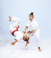 Children athletes train judo throws