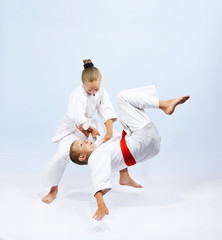 Judo athletes are training throws