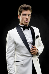 Tuxedo, Young fashion model with abdominals and stylish clothes