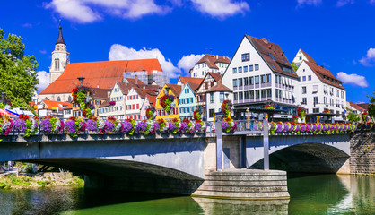 Fototapete - Beautiful towns of Germany - Tubingen, view of the bridge decorated with flowers