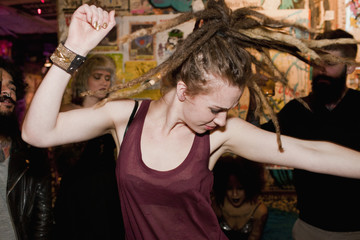 Young woman dancing at a club