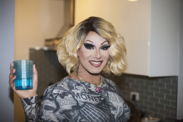 Drag queen holding a glass