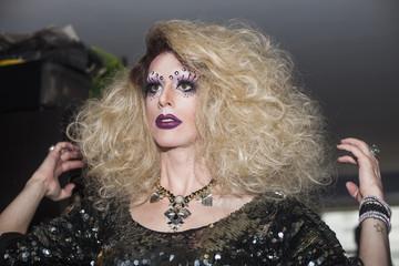 Drag queen standing indoors