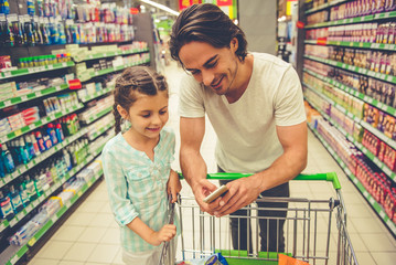 Dad and daughter in the supermarket