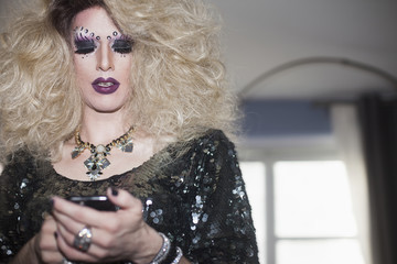 Drag queen using a cellphone
