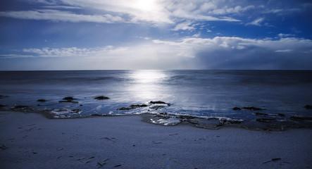 Sea surface at night moonlight. Winter, snow, hoarfrost on coast