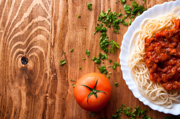 Italian spaghetti on a wooden table with text space