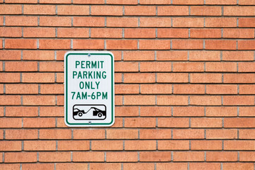 Brick wall with a sign for permit parking