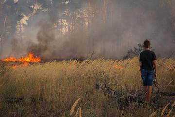 wildfire. danger, a person near fire