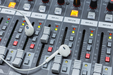 In ear monitors on a analog audio mixing console .