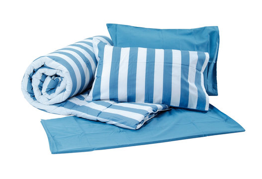 Blue set of pillows and blanket isolated on white background with clipping path.