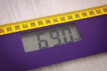 Digital bathroom scale with tape measure, slimming concept