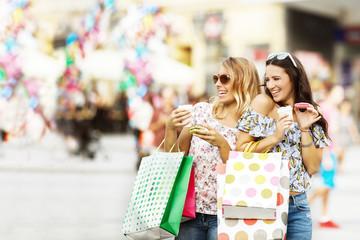 Beautiful young women enjoying shopping.