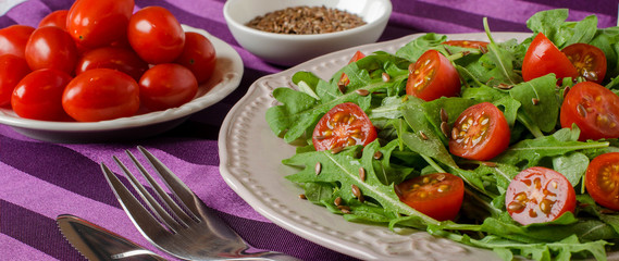Healthy Breakfast with arugula and cherry tomatoes.