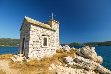 little old chapel on the island, sea in the background