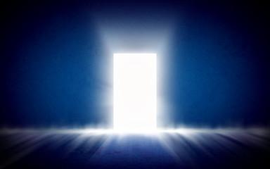 Glowing exit from dark room, open door