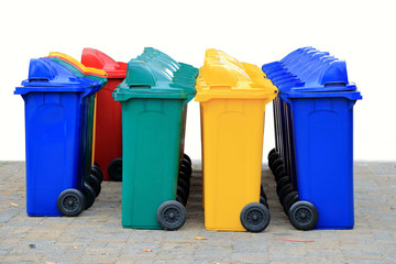 group of new large colorful wheelie bins for rubbish, recycling