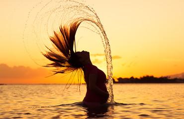 Hair flip against beautiful sunset.