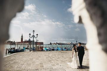 Newlyweds couple walking in Venice