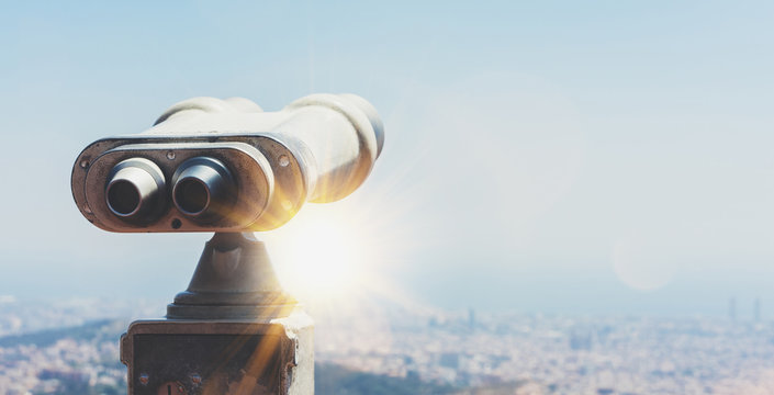 Touristic telescope look at the city with view of Barcelona Spain, close up old metal binoculars on background viewpoint overlooking the mountain, hipster coin operated in panorama observation, mockup