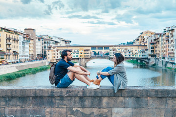 Couple at sunset in front of Ponte Vecchio Florence