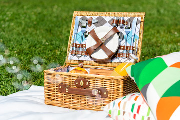 Picnic Basket Food On White Blanket With Pillows And Soap Bubbles