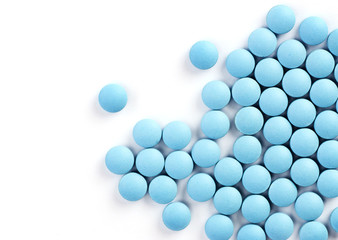blue drugs on white background