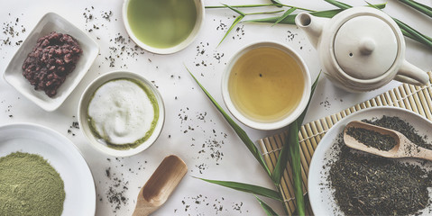 japanese green tea set on white table background. over light and vintage tone