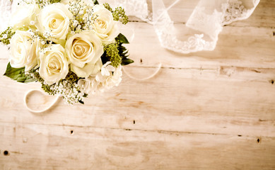 Bridal Bouquet with White Roses and Lace Veil
