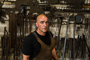 Portrait of blacksmith in his workshop