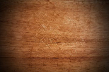 Old scratched wooden cutting board texture