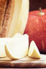 Delicious slices of honey Uzbekistan melon, black background, to