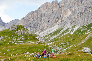 Hikers resting on rocky hillside by mountain, Austria