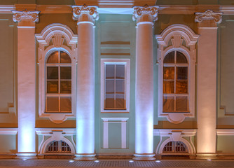 Several windows and columns in a row on night illuminated facade of the State Hermitage Museum front view, St. Petersburg, Russia