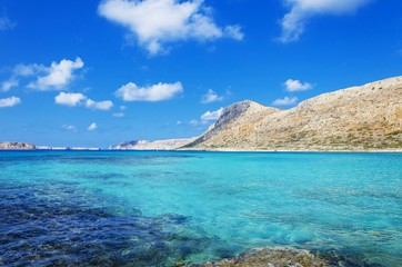 Cliffs and turquoise waters at Balos beach in island of Crete, Greece