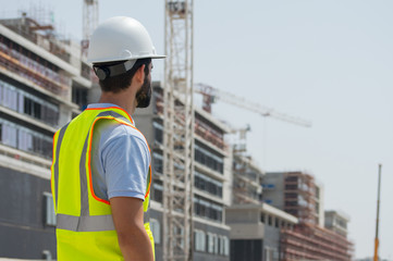 Engineer during a site visit, checking the facade working sequence