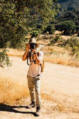 Man looking at camera, photographing, Malibu Canyon, California, USA