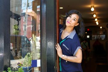 Portrait of smiling woman in restaurant doors