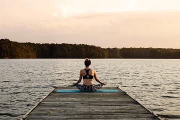 Rear view of woman wearing spandex by lake, North Carolina, USA
