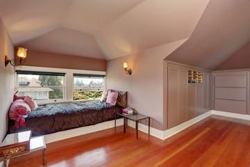 Bedroom interior with hardwood floor and comfortable rest area