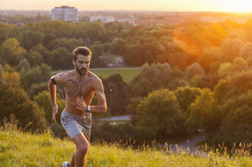 Man running  in park at sunset