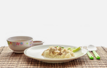 Hainanese chicken rice with soup, sauce. Ready to eat by the window.