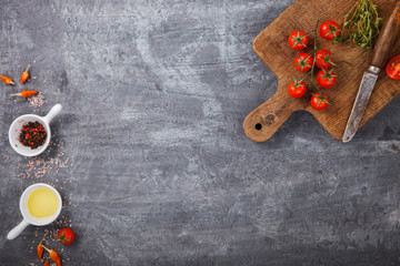 Organic vegetarian ingredients, olive oil and seasoning on rustic wooden cutting board over dark vintage background with space for text. Healthy food, vegan or diet nutrition concept.selective focus.