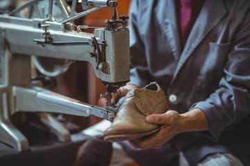 Shoemaker using sewing machine