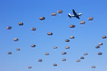 paratroopers jumping out of their planes