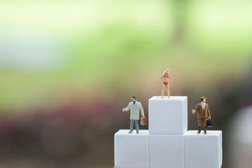Miniature figures, sexy female in bikini and business man figure