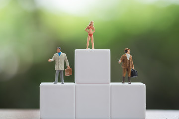 Miniature figures, sexy female in bikini and business man figure